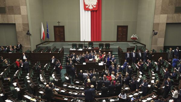Polish opposition parliamentarians protest against the rules proposed by the head office of the Sejm, the lower house of parliament, ban all recording of parliamentary sessions except by five selected television stations and limits the number of journalists allowed in the building, in the Parliament in Warsaw, Poland December 16, 2016 - Sputnik International