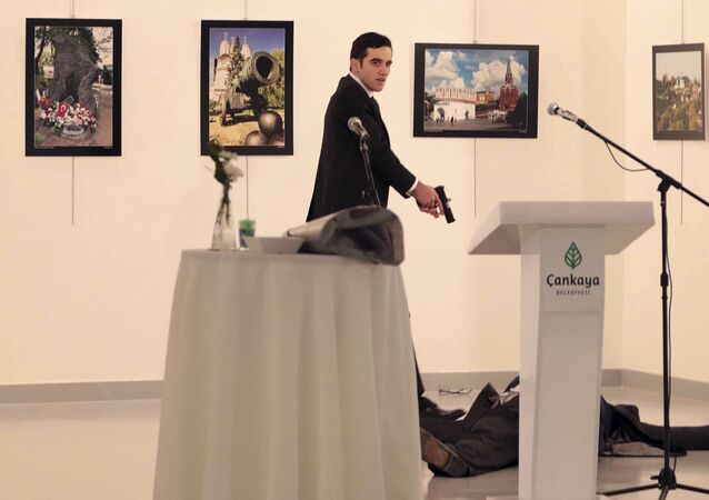 An unnamed gunman shouts after shooting the Russian Ambassador to Turkey, Andrei Karlov, at a photo gallery in Ankara, Turkey, Monday, Dec. 19, 2016