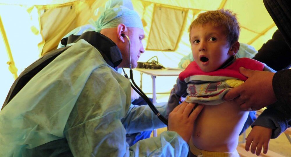 Russian doctor inspects a Syrian boy for signs of respiratory infection