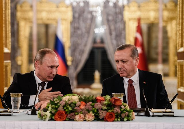 (FILES) This file photo taken on October 10, 2016 shows Russian President Vladimir Putin (L) speaking to Turkish President Recep Tayyip Erdogan (R) as they attend a press conference in Istanbul