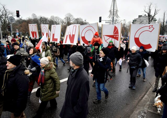 People hold signs of letters composing the word 'Freedom' as they march in an anti-government protest in Warsaw, Poland December 18, 2016.