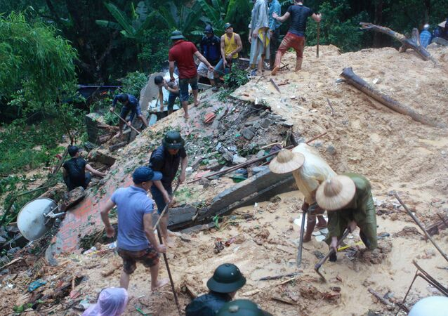 People search at a landslide site caused by violent floods. Vietnam (File)