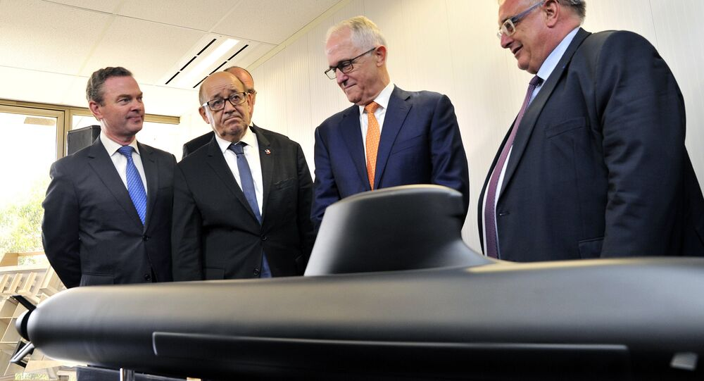 Australian Prime Minister Malcolm Turnbull, second right, stands with French Defense Minister Jean-Yves Le Drian, second left, Australian Defence Industry Minister Christopher Pyne, left, and Herve Guillou, chief executive officer of DCNS, a French state majority-owned company that will design the Shortfin Barracuda subs, as they look at a model of a submarine at the opening of the Australian headquarters of DCNS in Adelaide, Australia, Tuesday, Dec. 20, 2016