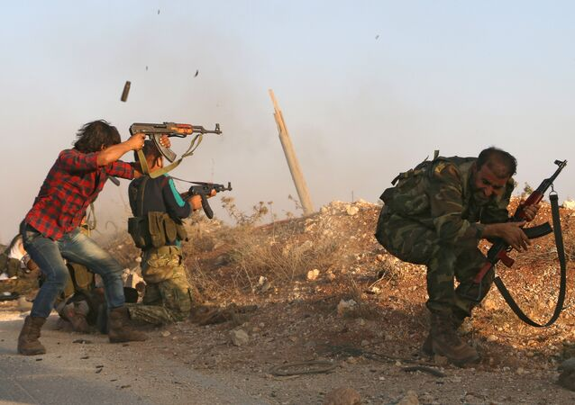 Fighters from the Free Syrian Army take part in a battle against the Daesh group jihadists in the northern Syrian village of Yahmoul in the Marj Dabiq area north of the embattled city of Aleppo on October 10, 2016