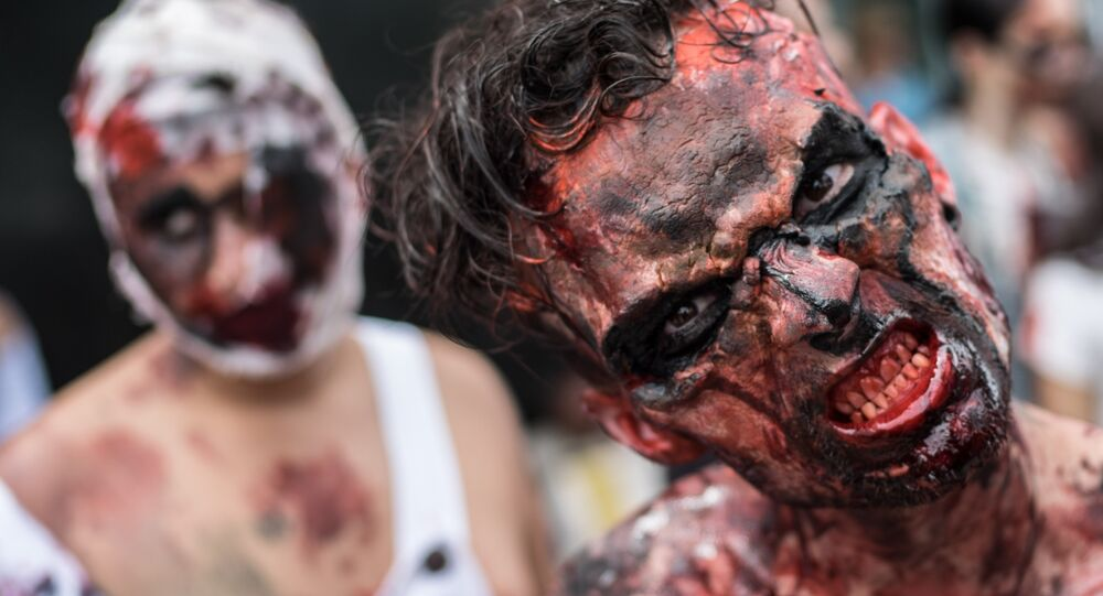 A man takes part in a Zombie Walk on the Day of the Dead along Copacabana beach in Rio de Janeiro, Brazil, on November 2, 2015