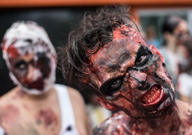 A man takes part in a Zombie Walk on the Day of the Dead along Copacabana beach in Rio de Janeiro, Brazil, on November 2, 2015