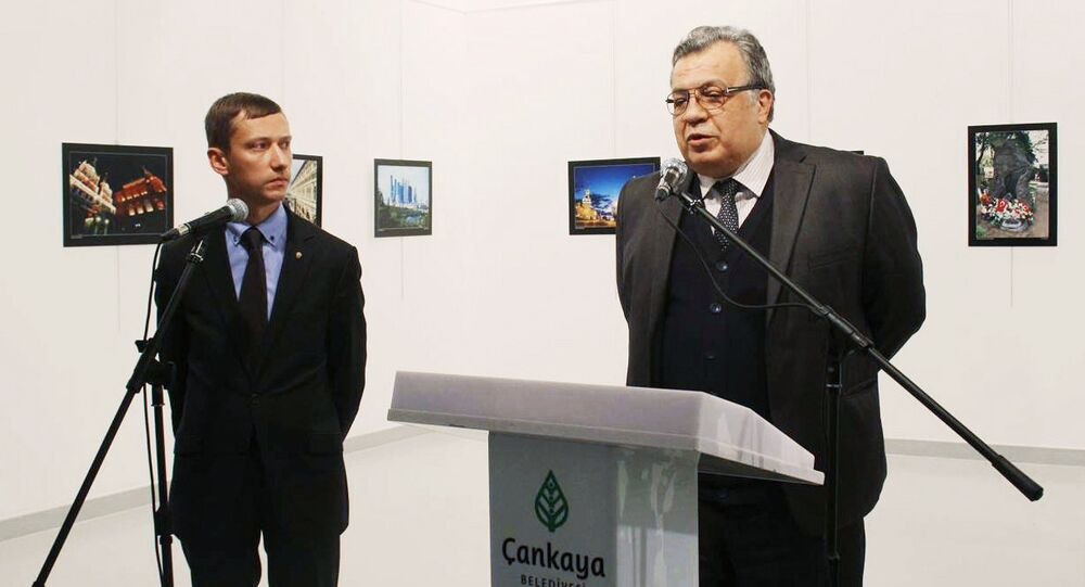 Russian Ambassador Andrei Karlov (right) at the opening of a photo exhibition in the Center of Modern Art in Ankara. (The image is a hand-out material granted by a third party. Editorial use only. Archivation, commercial use or promotional campaign are banned). Photo by ANADOLU/RIA Novosti