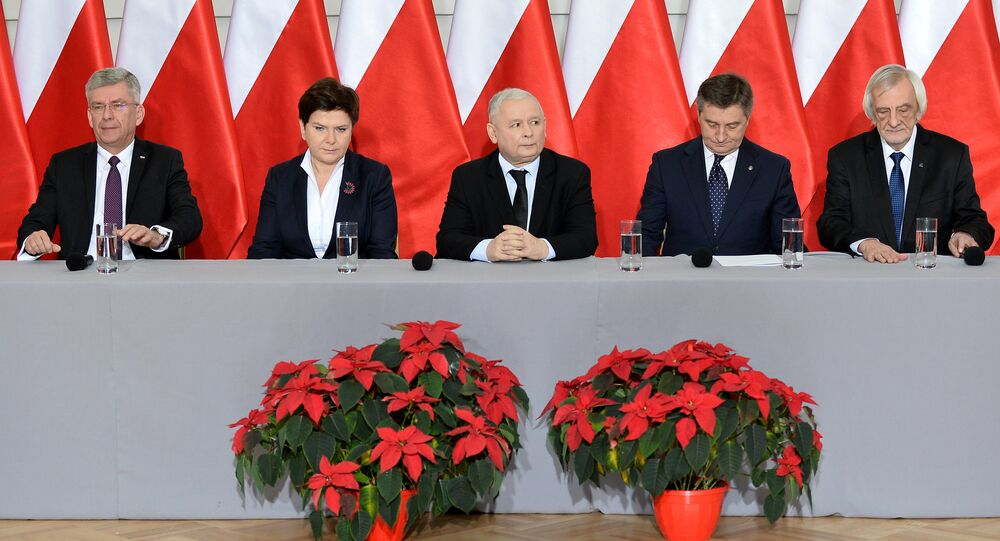 (L-R) The speaker of the Polish Senate Stanislaw Karczewski, Polish Prime Minister Beata Szydlo, the leader of the PiS (Law and Justice) party Jaroslaw Kaczynski, the speaker of the parliament Marek Kuchcinski and the deputy speaker of the parliament Ryszard Terlecki attend a press conference on December 21, 2016 in Warsaw