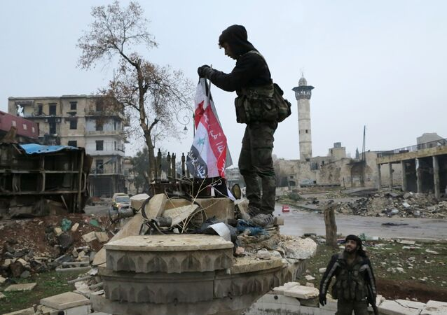 Servicemen in the liberated district of eastern Aleppo