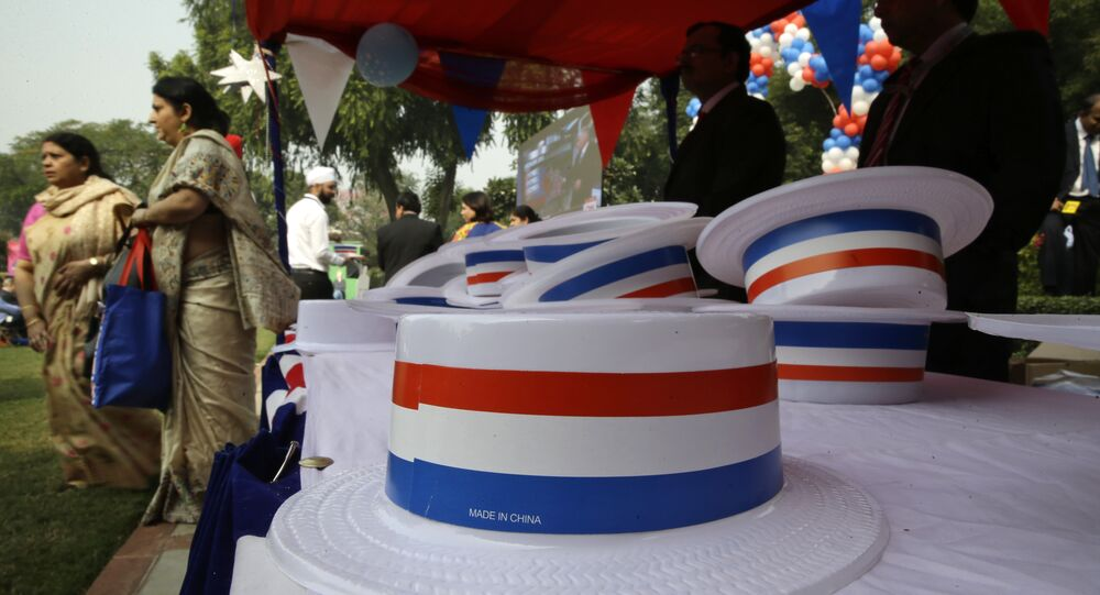 Hats in U.S. national colors made in China are kept for the use of people coming in to watch the counting of votes for the U.S. presidential elections, at the U.S. ambassador's residence, in New Delhi, India, Wednesday, Nov. 9, 2016