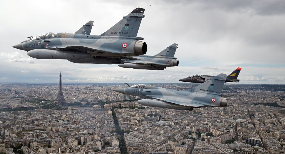 FILE PHOTO - Four Mirage 2000C and one Alpha jet flight over Paris, France, on their way to participate in the Bastille Day military parade, July 14 2016
