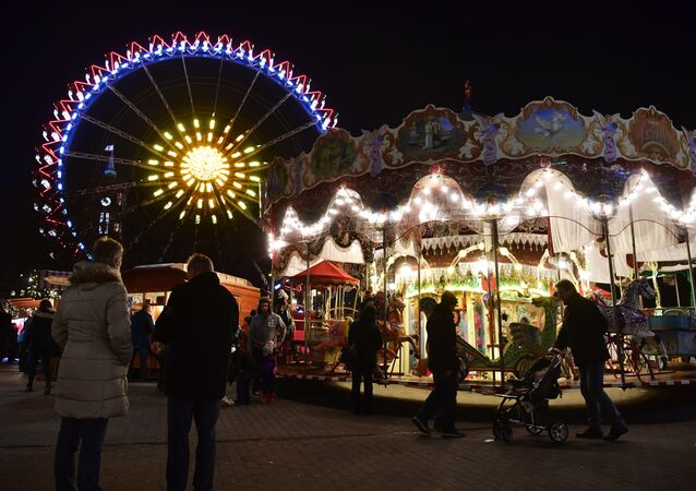 People visit the Christmas market at Berlin's Alexanderplatz with its big wheel, two days after an attack at the Christmas market near the Kaiser-Wilhelm-Gedaechtniskirche (Kaiser Wilhelm Memorial Church), in central Berlin, on December 21, 2016