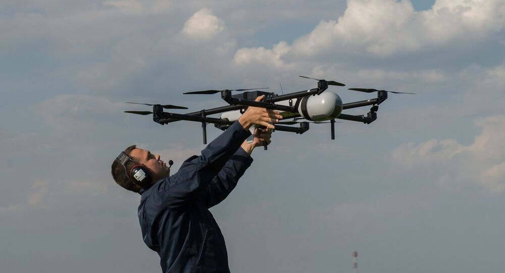 A man prepares to launch an unmanned aerial vehicles (UAV) during UAV demonstration flights. (File)