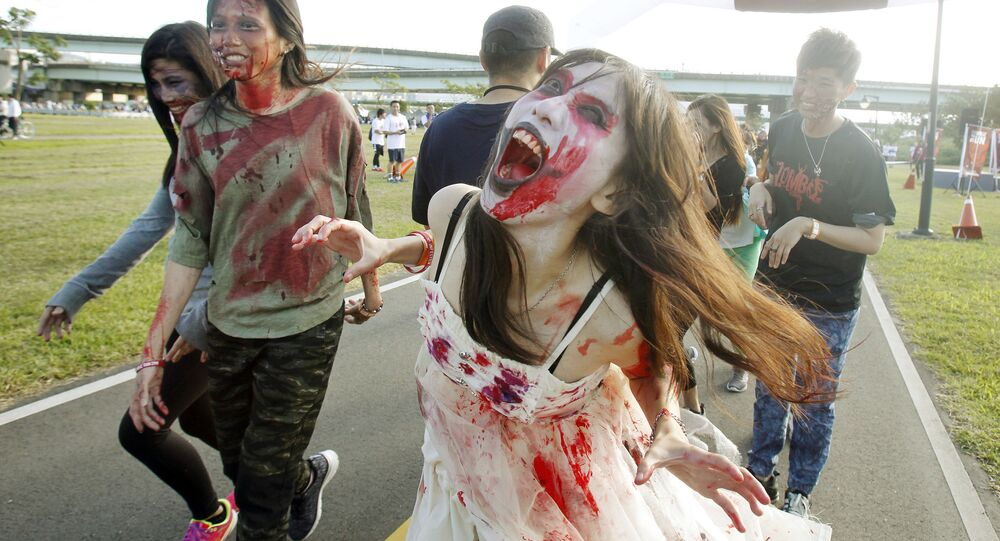 Runners dressed as zombies race during the Zombie Run Taiwan at the Fu Zhou Riverside Park in New Taipei City, Taiwan