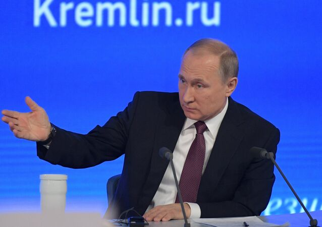 Russian President Vladimir Putin attends his annual end-of-year news conference in Moscow, Russia