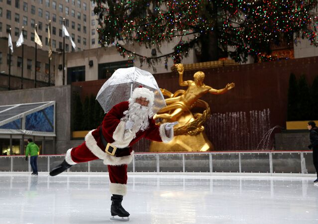 A man dressed as Santa Claus ice skates at The Rink At Rockefeller Center on Christmas Eve in Manhattan, New York City, US.