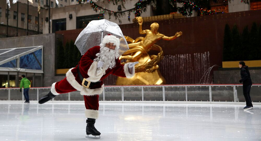 A man dressed as Santa Claus ice skates at The Rink At Rockefeller Center on Christmas Eve in Manhattan, New York City, U.S