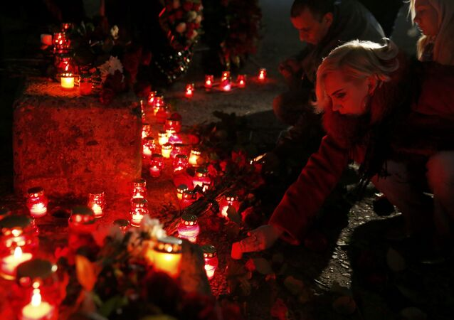 People place candles to honour passengers and crew members of Russian military Tu-154 plane crashed into the Black Sea on its way to Syria on Sunday in the resort city of Sochi, Russia