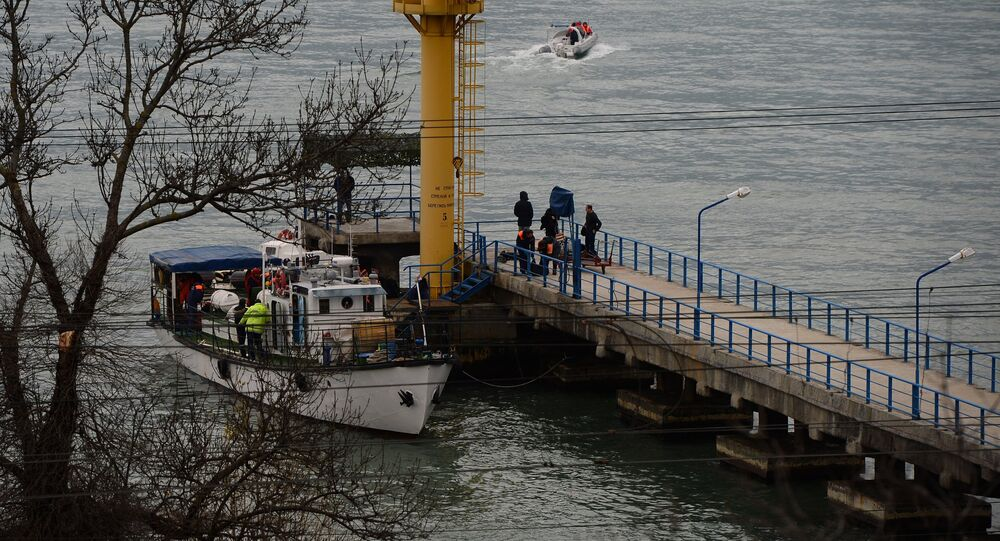 Russian Emergencies Ministry members work at a quay of the Black Sea near the crash site of Russian military Tu-154 plane, in the Sochi suburb of Khosta, Russia, Russia December 25, 2016