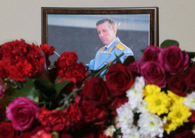 A photo of Russian Army Bandmaster Lieutenant General Valery Khalilov, who died in the Russian Defense Ministry's Tu-154 crash, is seen here outside the building of The Alexandrov Academic Ensemble of Song and Dance of the Russian Army in Moscow
