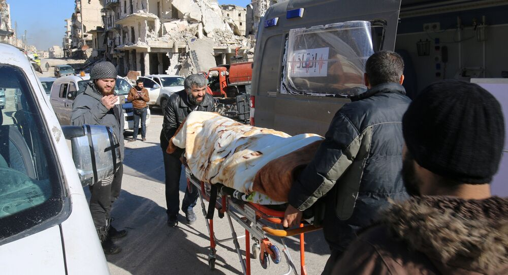 Men push an evacuee on a stretcher as vehicles wait to evacuate people from a rebel-held sector of eastern Aleppo, Syria December 15, 2016