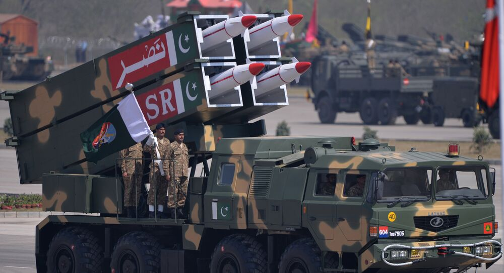 Pakistani military personnel stand beside short-range Surface to Surface Missile NASR during the Pakistan Day military parade in Islamabad on March 23, 2015