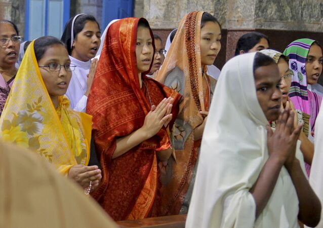 Indian Catholics pray for the safe release of Catholic priest Tom Uzhunnalil at the St. Francis Xavier's Cathedral, in Bangalore, India, Monday, April 4, 2016