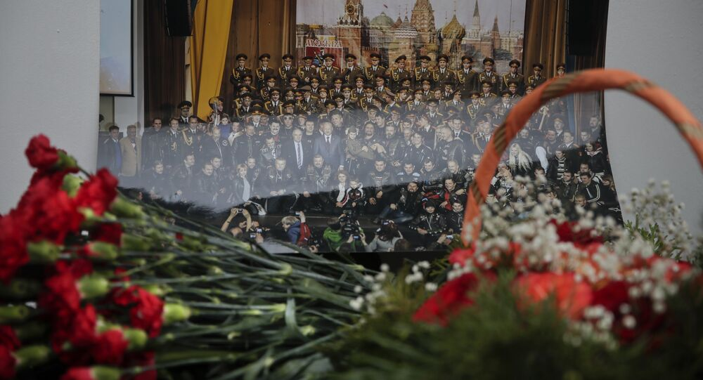 Flowers lay in front of a photo of a well-known military choir lays flowers at the military choir's building in Moscow, Russia, Sunday, Dec. 25, 2016, after a plane carrying 64 members of the Alexandrov Ensemble, crashed into the Black Sea minutes after taking off from the resort city of Sochi