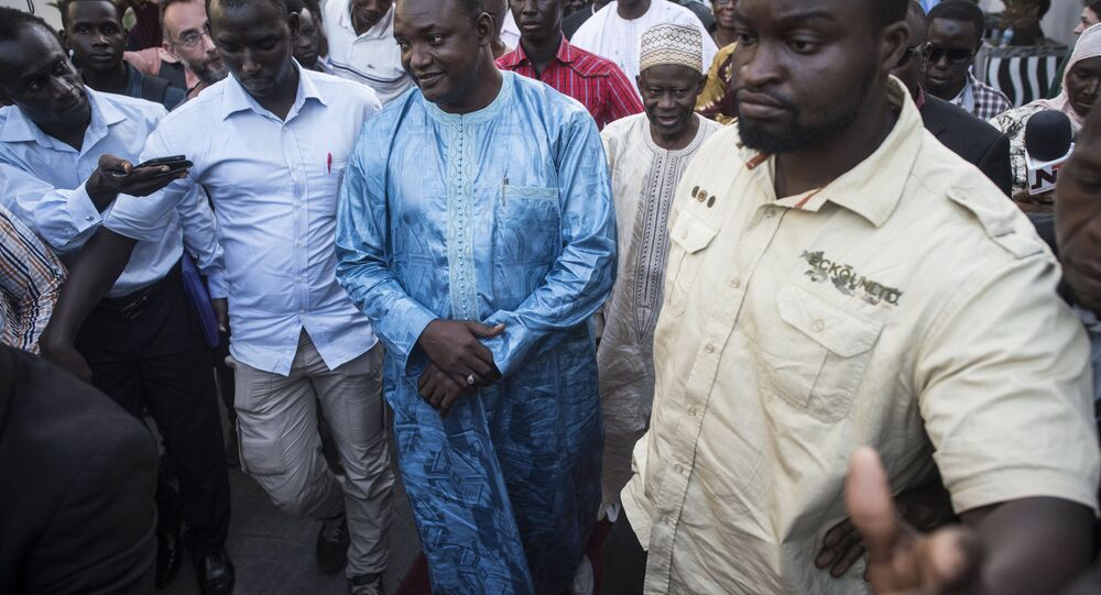 Gambia President elect, Adama Barrow, centre, walks after a meeting with Ecowas delegation in Banjul, Gambia, Tuesday, Dec. 13, 2016. Gambia's ruling party pressed for fresh elections, as West African regional mediators intervened Tuesday to try to resolve a political crisis in the tiny West African country that voted its leader of 22 years from power. (AP Photo/ Sylvain Cherkaoui)