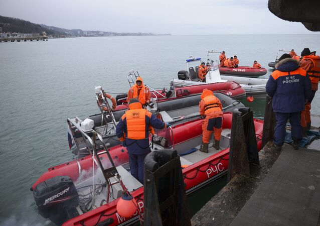 Ministry of Emergency Situations employees prepare rescue boats at a pier just outside Sochi, Russia, Monday, Dec. 26, 2016