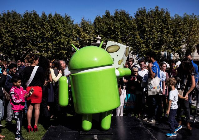 People stand next to a statue donated by Google during its inauguration on September 21, 2016 in Montelimar, as Google decided to launch a new version of the android operating system called Android 7.0 or Nougat