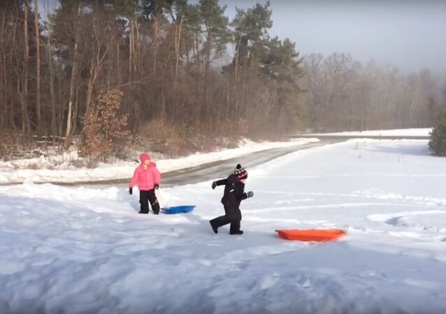 Christmas Sled Gets Away from Boy