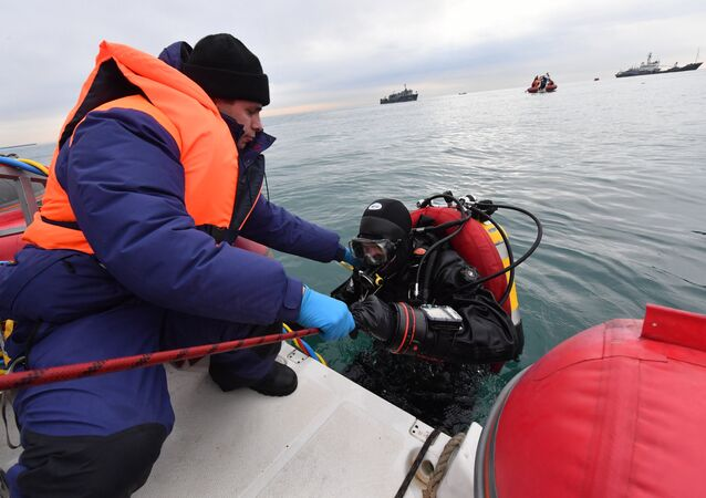 Emergencies Ministry rescuers during a search operation at the crash site in the Black Sea near Sochi.