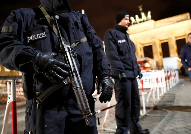 German police provide security at the Brandenburg Gate, ahead of the upcoming New Year's Eve celebrations in Berlin, Germany December 27, 2016