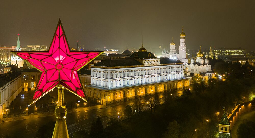 The star atop the Vodovzvodnaya Tower of the Moscow Kremlin. Right: the Grand Kremlin Palace, and the Church of St. John Climacus the Ivan the Great Bell Tower