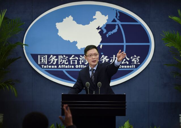 An Fengshan, spokesman for the State Council's Taiwan Affairs Office, gestures toward the media at a press conference in Beijing on December 28, 2016