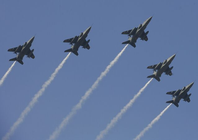 Indian Air Force jet fighters fly over India Gate as part of the Republic Day Parade rehearsal, on January 21, 2011