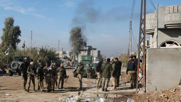 Iraqi rapid response forces gather during a fight with Islamic State militants in Intisar district of eastern Mosul, Iraq, December 22, 2016 - Sputnik International
