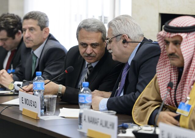 Members of the Syrian interior opposition Mahmoud Marai (3R) listens to Elian Mous'ad (2R) during a meeting with UN Syria Envoy during Syria peace talks at the United Nations Office on April 22, 2016 in Geneva