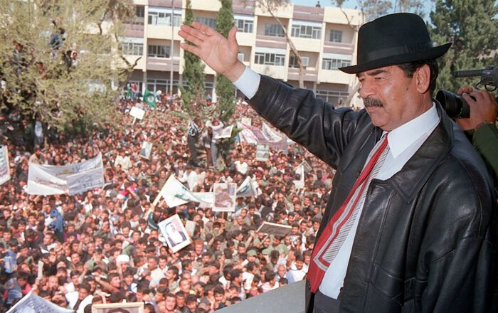 A photo released by Iraqi Press Agency 02 April shows President Saddam Hussein waving to supporters during his visit to the town of Kirkuk north of Baghdad.