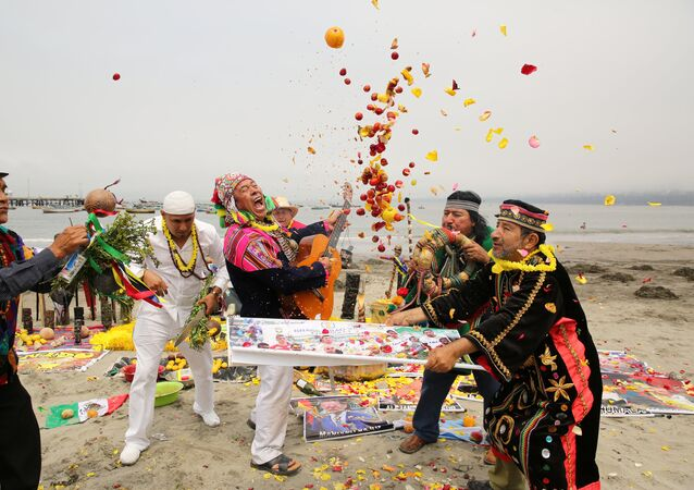 Peruvian shamans perform a ritual of predictions for the new year at Pescadores beach in Chorrillos, Lima, Peru, December 29, 2016.