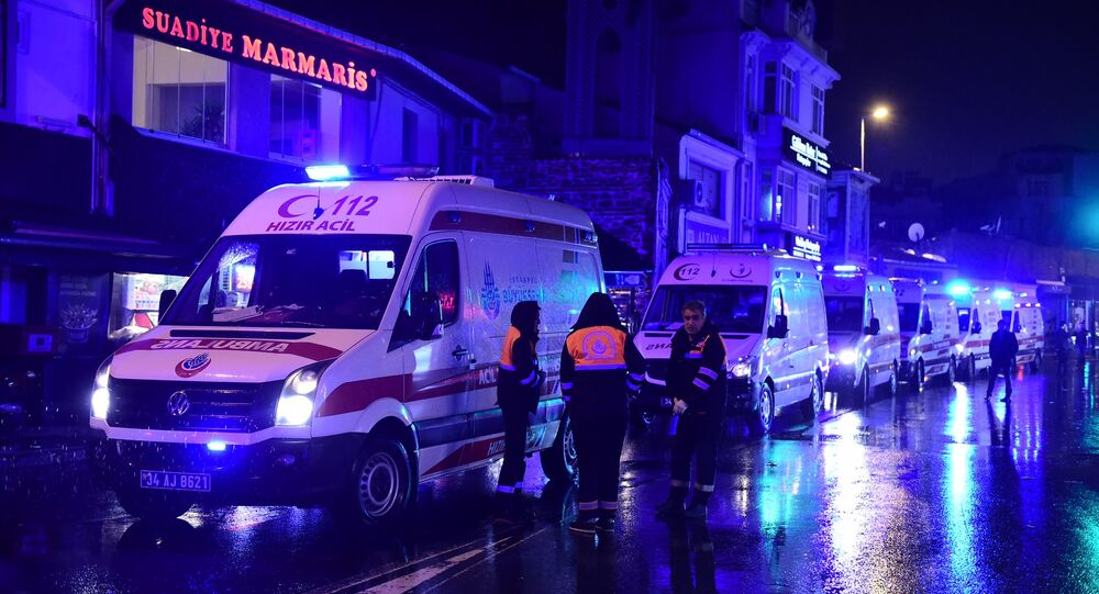 Ambulances are seen at the site of an armed attack January 1, 2017 in Istanbul.