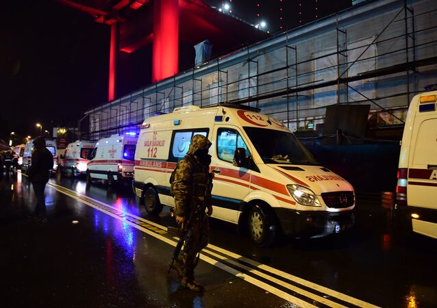 Turkish special force police officers and ambulances are seen at the site of an armed attack January 1, 2017 in Istanbul.