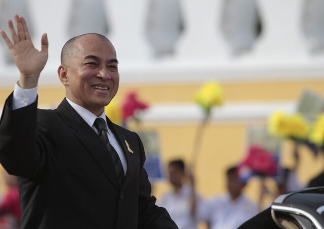 Cambodia's King Norodom Sihamoni greets well-wishers during an Independence Day celebration in front of Royal Palace in Phnom Penh, Cambodia, Saturday, Nov. 9, 2013. The King attended the celebration to mark the country's 60th Independence Day from France.