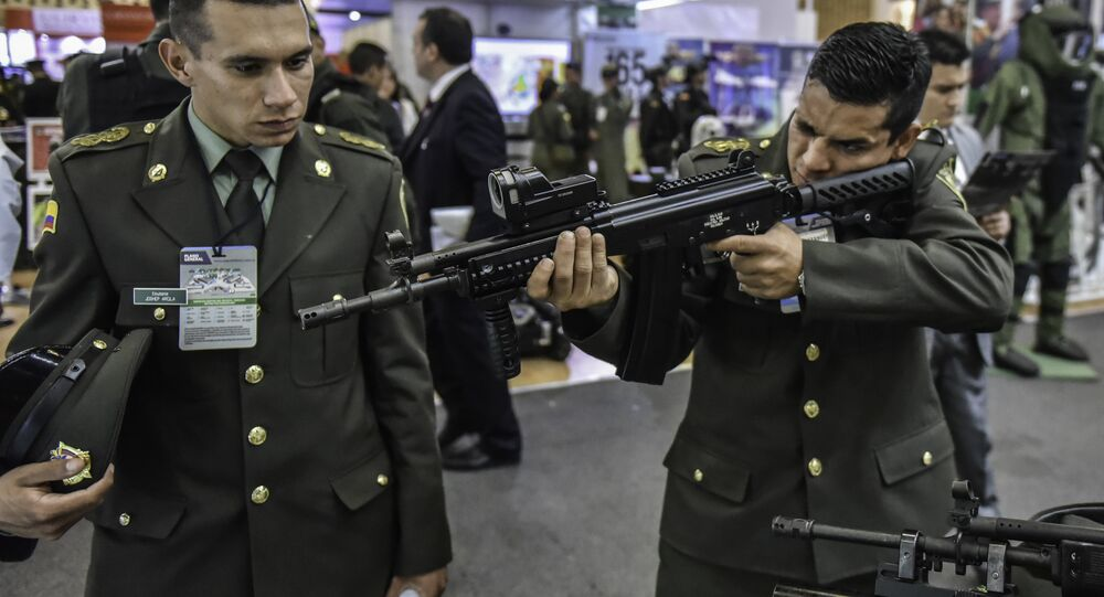 A Colombian policeman holds a Colombian-made Israeli Galil ACE assault rifle during the Expodefence Fair 2015, in Bogota on November 30, 2015