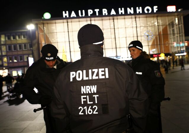 German police officers gather near the Hauptbahnhof before New Year celebrations for 2017 in Cologne, Germany, December 31, 2016