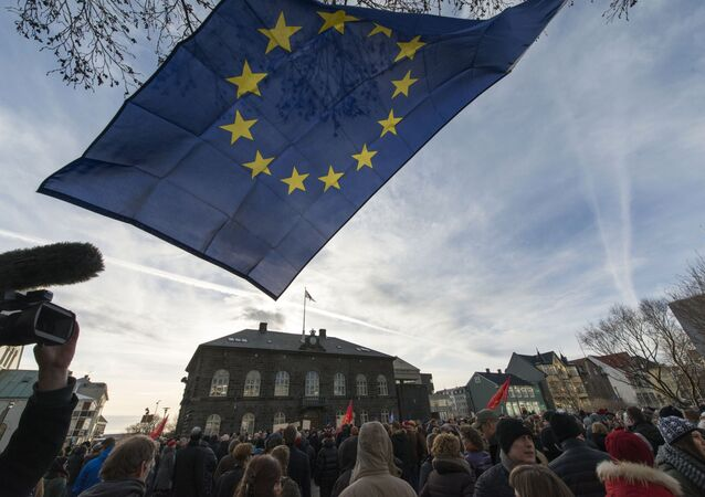 Thousands of protesters gather in front of the Parliament in the Icelandic capital Reykjavik on February 24, 2014 to demand a referendum amid a government bid to pull out of EU accession talks without a popular vote.