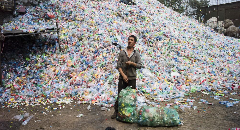 Chinese labourer sorting out plastic bottles for recycling in Dong Xiao Kou village, on the outskirt of Beijing (File)
