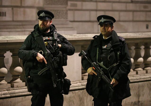Armed British police officers stand on duty ahead of the New Year's celebrations, in central London.