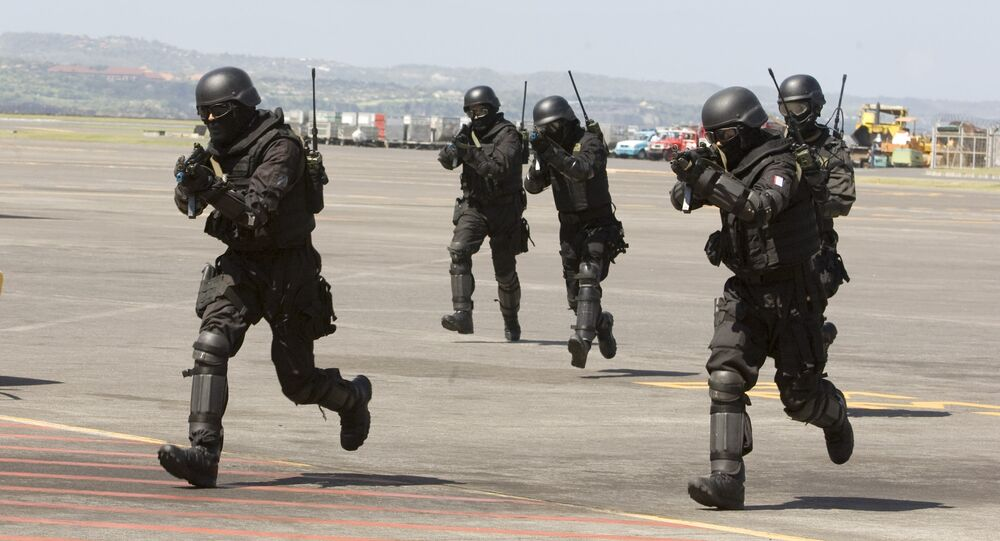 Indonesian Special Forces soldiers, also known as Kopassus, take position during a joint anti-terrorism exercise with Australia's elite unit SAS at the Bali International Airport, in Kuta, Indonesia on Tuesday, Sept. 28, 2010
